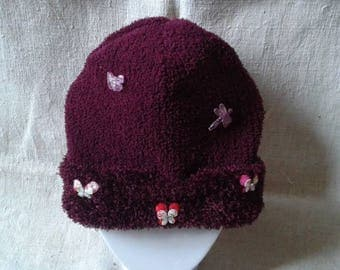 Burgundy hat and small butterflies