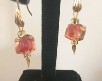 Pastel red/pink colored offset cube earring