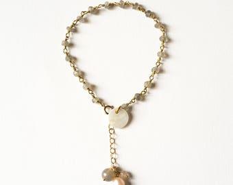 Adjustable silver bracelet gilded with gold end and Labradorite