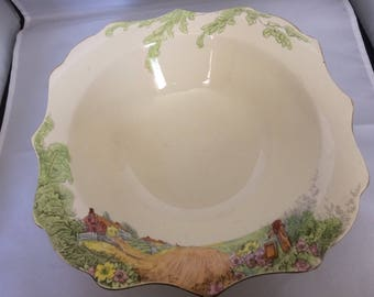 Sunderland ware large fruit bowl , Large bowl , scenic decoration , collectors item , fluted edge , gilding , cream with country scene