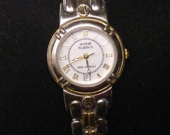 Anne Klein II 10-1680-1. Two tone quartz watch with date. Stainless steel white/silver with gold accent.