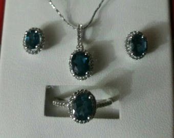 Beautiful Blue topaz and sterling silver necklace, earrings and ring set
