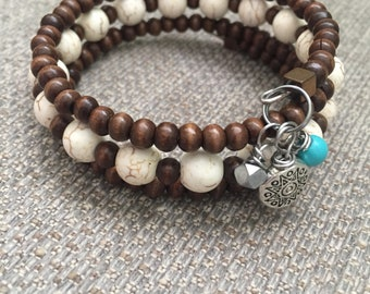 Brown wood and white turquoise howlite wire wrap bracelet .