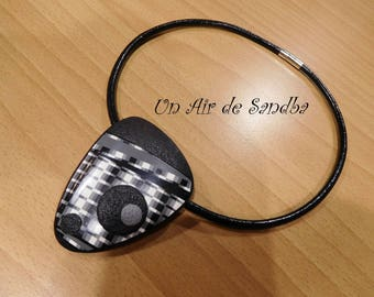 """Black"" polymer clay and leather necklace."