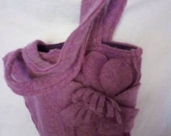 Boiled wool lined with cotton bag.