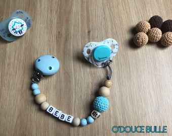 Natural wood and very light blue pacifier clip