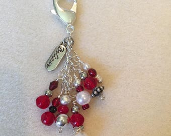 Purse charm/keychain in silver and red tones