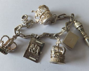 Silver charm bracelet with chunky charms