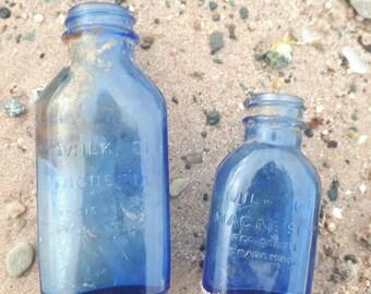 2 different sized milk of magnesia vintage bottles,cobalt blue bottle,dug up sold as found.