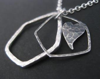 Silver hexagon heart pendant