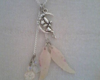 fairy sitting on Moon, fluorescent wings necklace