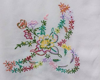 Vintage embroidered white linen table cloth.