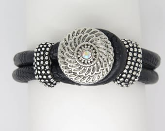 CUFF BRACELET IN BLACK LEATHER WITH BEADS AND METAL CENTRAL PATTERN