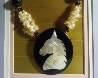 Unicorn necklace with inlaid Mother of Pearl and Mother of Pearl bead strands.  1970s