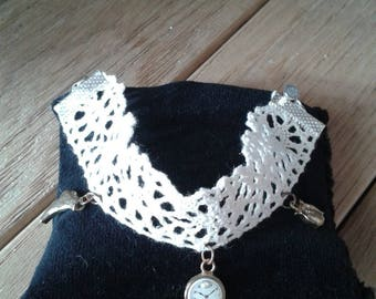 Copper bracelet beige embroidered lace embellished with 3 pendants