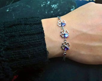 Silver plated heart-shaped clovers with purple rhinestones!