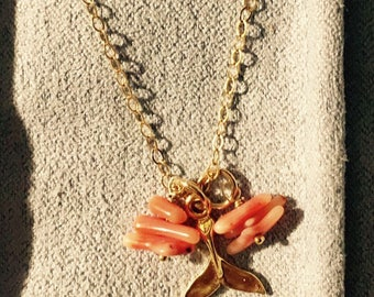 dolphin tale charm necklace with vintage coral