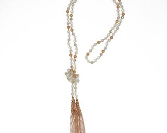 White beaded lariat with gold tassel accents