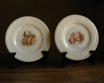 Two French antique porcelain plates with cherubs