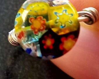 Single presses glass bead ring