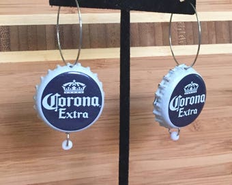 Corona beerings made from up-cycled beer bottle caps. Choose from a dangly or hoop style earring down below.