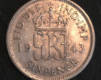 A 1943 King & Emperor George VI .500 silver English sixpence coin