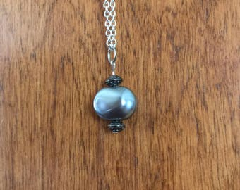 Blue-gray glass nugget with pewter-tone rondel beads pendant