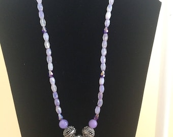 Purple stone pendant with sparkly crystal