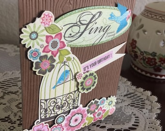 Handmade Birthday Card, Sing Your Song, It's Your Birthday! Bird cage surrounded by beautiful flower die cuts, female card, dimensional