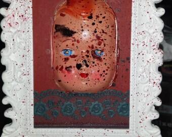Creepy doll-face