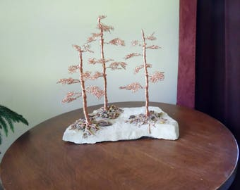 COPPER WIRE SCULPTURE~Handcrafted on Limestone Rock~a Beautiful, Eye catching Piece~Rock is a wheat color or Beige about 3 /4 inch thick.