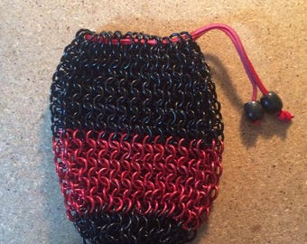 Chainmail dice bag made with 16g red and black anodized aluminum rings.