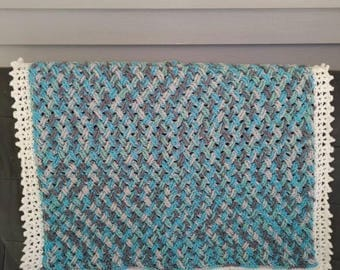 Crochet Celtic weave multi-colored baby blanket with white picot border