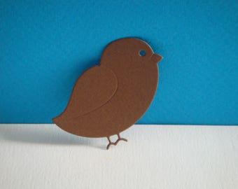 Cut little bird in brown paper