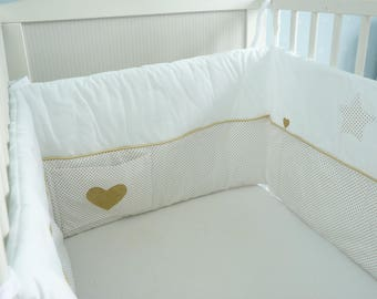 Gold and white bumper holding 3 cushions in one