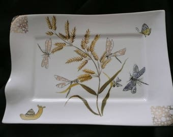 Hand painted porcelain rectangular dish decorated with 4 dragonflies on a grass field, with a butterfly and snail