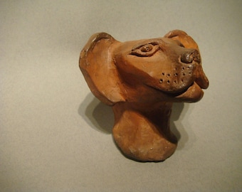 Figurine in Terra-cotta raw waxed says: Pink panter