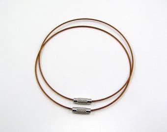 Set of 2 bracelets cable stiff diameter 68 mm orange