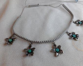 Metal and turquoise flower macrame necklace