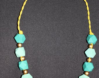 Green and gold wooden necklace