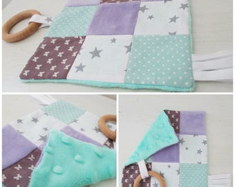 Flat sensory blanket with purple and green toy teether 1 age