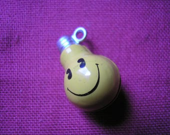 Bell depicting a small bulb emoticon