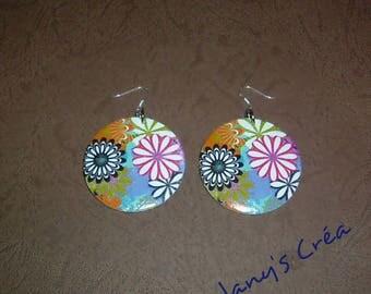 Three pairs of painted wood earrings