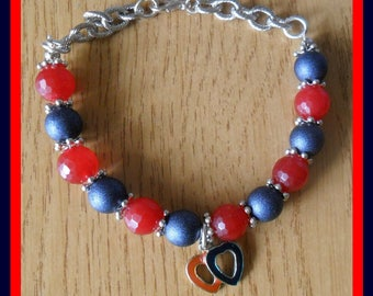 Red and blue metallic bracelet with pendant