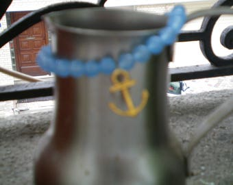 blue glass beads and gold anchor bracelet