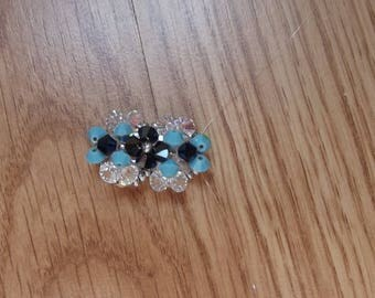 Blue swarovski ring.