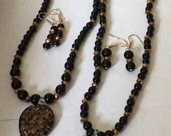 Black onyx bead with black pendant