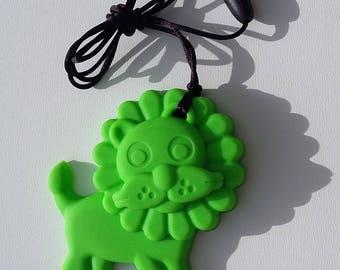 Teething ring, animal lion. Green.