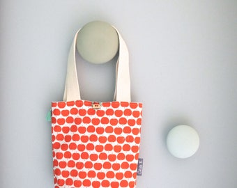 bag child shape bucket in orange and white cotton lined with blue waterproof fabric