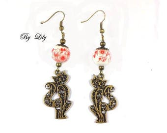 """Earrings """"Bronze cat and Red flowered beads""""."""